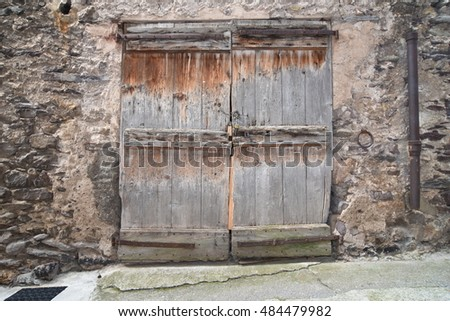 Valdeblore, France - September 17, 2016 : Old wooden door pictured in a mountain village in France