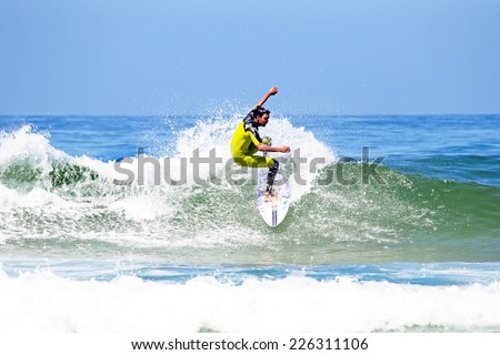 VALE FIGUEIRAS -  AUGUST 20: Professional surfer surfing a wave on august 20 2014 at Vale Figueiras in Portugal - stock photo
