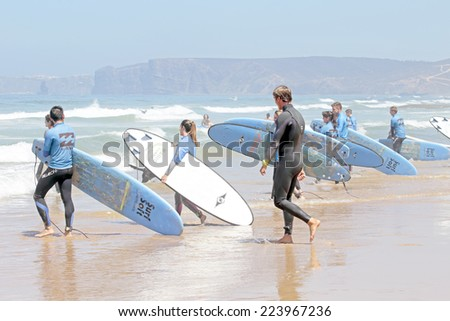 VALE FIGUEIRAS, PORTUGAL - August 20 2014:  Surfers getting surf classes on the famous surfers beach Vale Figueiras in Portugal - stock photo