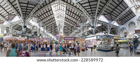 VALENCIA - AUGUST 11: Customers shopping at the Central Market, Mercado Central on August 11, 2014 in Valencia, Spain.