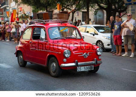 VALENCIA - JUL 10: Seat 600, a classic car participating in San Cristobal brotherhood celebrations on July 10, 2012 in Valencia, Spain. - stock photo