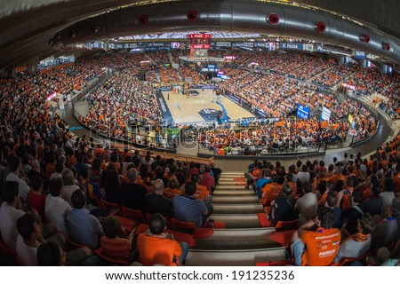 VALENCIA - MAY, 1: Crowd of people in Fonteta stadium during a Eurocup Finals match between Valencia Basket Club and Unics Kazan on May 1, 2014 in Valencia, Spain - stock photo