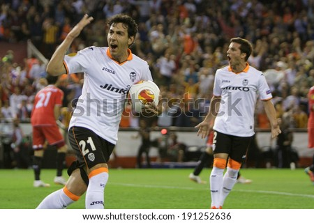 VALENCIA - MAY, 1: Parejo with ball and Piatti celebrate goal during UEFA Europe League semifinals match between Valencia CF and Sevilla FC at the Mestalla Stadium on May 1, 2014 in Valencia, Spain - stock photo