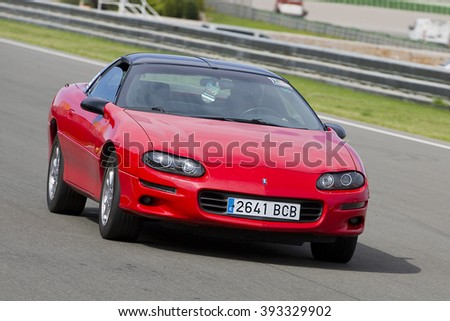 VALENCIA, SPAIN - APRIL 25: A red Chevrolet Camaro take part in American Fest weekend organized in circuit Ricardo Tormo, on April 25, 2015, in Cheste, Valencia, Spain. - stock photo