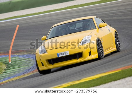 VALENCIA, SPAIN - APRIL 25: A yellow Nissan GTR take part in American Fest weekend organizated in circuit Ricardo Tormo, on April 25, 2015, in Cheste, Valencia, Spain.