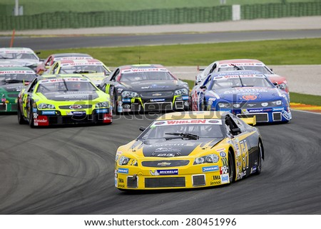 VALENCIA, SPAIN - APRIL 25: Some cars compete at Race 1 Elite 1 of Nascar Whelen Euro Series in Ricardo Tormo circuit, on April 25, 2015, in Cheste, Valencia, Spain. The winner was Eddie Cheever (51). - stock photo