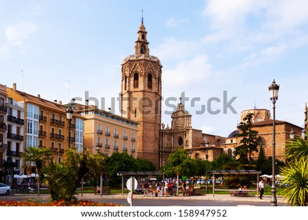 VALENCIA, SPAIN - AUGUST 27: View of Plaza de la Reina on August 27, 2013 in Valencia, Spain. Micalet tower and Saint Mary's Cathedral