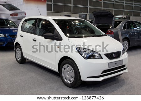 VALENCIA, SPAIN - DECEMBER 7 - A 2012 Five-door SEAT Mii Super-Compact Vehicle at the Valencia Car Show on December 7, 2012 in Valencia, Spain. - stock photo