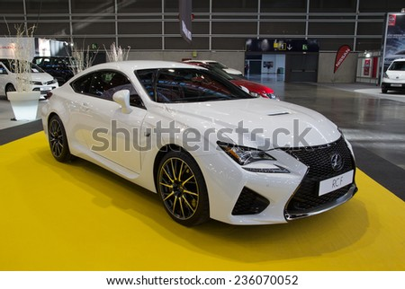 VALENCIA, SPAIN - DECEMBER 4, 2014: A 2015 white Lexus RC F sports car at the Valencia Automovil 2014 Car Show. The RC  F is a high performance car manufactured by Lexus, Toyota's luxury division. - stock photo