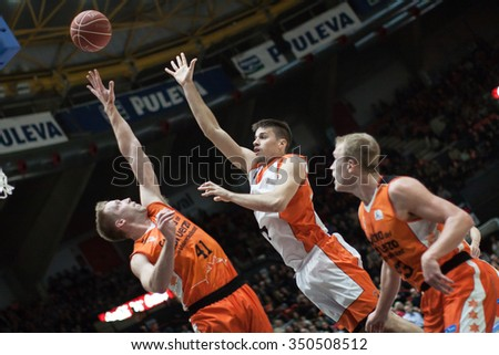 VALENCIA, SPAIN - DECEMBER 12th: Hamilton (L), Stevic (C), Sikma (R) during match between Valencia Basket Club and Montakit Fuenlabrada at Fonteta Stadium on December 12, 2015 in Valencia, Spain - stock photo