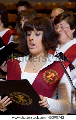 VALENCIA, SPAIN - DECEMBER 4: The choir of the University Catolica de Valencia performs at the Palau de la Musica concert hall on December 4, 2009 in Valencia, Spain. - stock photo