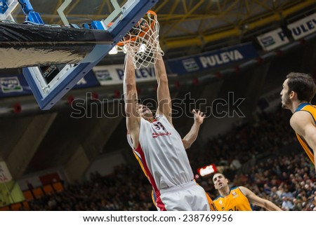 VALENCIA, SPAIN - DECEMBER 5: Zirbes with ball during Euroleague match between Valencia Basket Club and Crvena Zvezda Telekom Belgrade at Fonteta Stadium on Dicember 5, 2014 in Valencia, Spain - stock photo