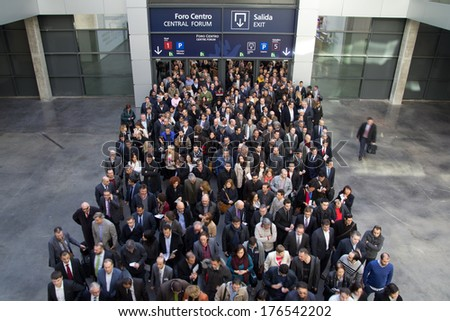 VALENCIA, SPAIN - FEBRUARY 12, 2014: A crowd of business people waiting to enter the 2014 Feria Habitat Valencia Trade Fair in Valencia.  - stock photo