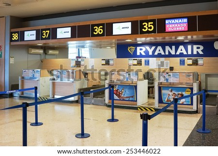 VALENCIA, SPAIN - FEBRUARY 14, 2015:  A Ryanair check-in counter at the Valencia airport. In 2014, Ryanair was the largest European airline by scheduled passengers carried. - stock photo