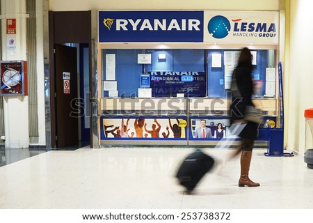 VALENCIA, SPAIN - FEBRUARY 14, 2015:  A Ryanair customer service counter at the Valencia airport. In 2014, Ryanair was the largest European airline by scheduled passengers carried. - stock photo