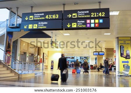 VALENCIA, SPAIN - February 7, 2015: Airline passengers inside the Valencia Airport. About 4.98 million passengers passed through the airport in 2014. - stock photo