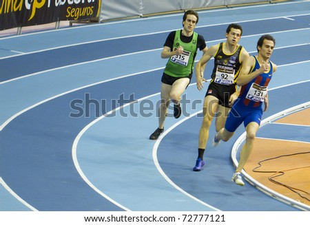 VALENCIA, SPAIN - FEBRUARY 19: Marc Orozco leads in the 400m Men race during the Spanish Indoor National Championships at Valencia on February 19, 2011 in Valencia, Spain - stock photo