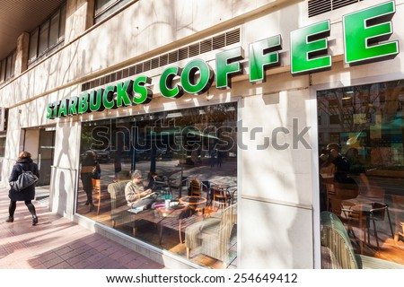 VALENCIA, SPAIN - FEBRUARY 09, 2015: Starbuck Coffee shop in the old town of Valencia with unidentified people. Its world largest Coffee Shop chains with 21,160 stores in 63 countries and territories - stock photo