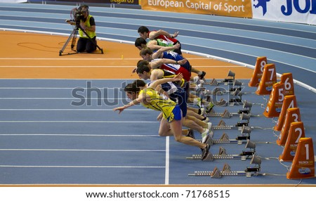 VALENCIA, SPAIN - FEBRUARY 20: Start of the Indoor track and field spanish national championship. Runners in the start line men's 60m sprint on February 20, 2011 in Valencia, Spain - stock photo