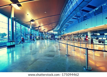 VALENCIA, SPAIN - JANUARY 14, 2014: Departures and check in area in Valencia airport -  situated 8 km from the city it is 8th busiest Spanish airport with flight connections to 15 European countries. - stock photo