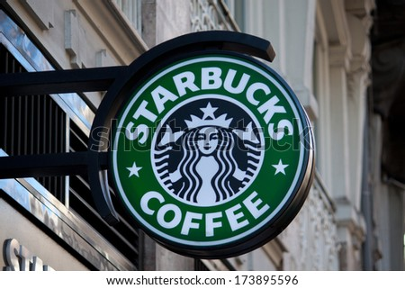 VALENCIA, SPAIN - JANUARY 27, 2014: Exterior of a Starbucks Coffee coffeehouse. Starbucks is the largest coffeehouse company in the world, with 20,891 stores in 62 countries (2013). - stock photo