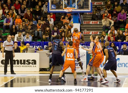 VALENCIA, SPAIN - JANUARY 28: Florent Pietrus (#20 player) in action during the ACB league match between Valencia Basket  and Asefa Estudiantes, 85-71, on January 28, 2012, in Valencia, Spain - stock photo
