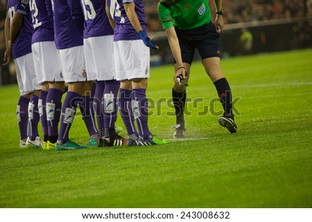 VALENCIA, SPAIN - JANUARY 4: Referee marks a lines during Spanish King Cup match between Valencia CF and RCD Espanyol at Mestalla Stadium on January 4, 2015 in Valencia, Spain - stock photo
