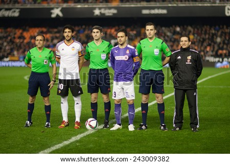 VALENCIA, SPAIN - JANUARY 4: Referee Team and captains of the teams during Spanish King Cup match between Valencia CF and R.C.D. Espanyol at Mestalla Stadium on January 4, 2015 in Valencia, Spain - stock photo