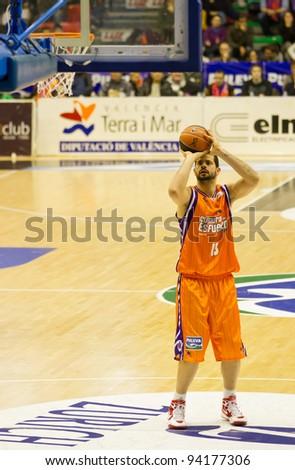 VALENCIA, SPAIN - JANUARY 28: Vitor Faverani (#13 player) free shot during the ACB league match between Valencia Basket  and Asefa Estudiantes, 85-71, on January 28, 2012, in Valencia, Spain - stock photo