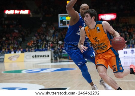VALENCIA, SPAIN - JANUARY 21: Vives with ball and Hayes during Eurocup match between Valencia Basket Club and CSU Asesoft at Fonteta Stadium on January 21, 2015 in Valencia, Spain - stock photo