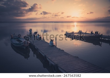 VALENCIA, SPAIN - JULY 14:Group of tourist in Albufera on July 14,2014 in Valencia, Spain.The Albufera is a freshwater lagoon on the Gulf of Valencia coast of the Valencian Community in eastern Spain. - stock photo