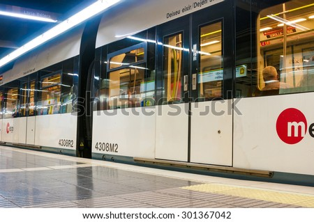 VALENCIA, SPAIN - JULY 14, 2015: Metro train on Jesus station in Valencia, Spain. The total length of subway lines Valencia is 144 km, and the number of stations - 171