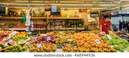 VALENCIA, SPAIN - JULY 20, 2016: Vendors Selling Fresh Fruits In Mercado Central (Mercat Central or Central Market), One Of The Largest Market Places In Valencia.