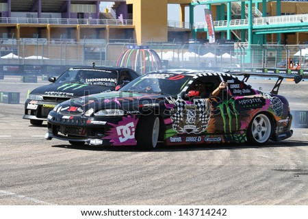 """VALENCIA, SPAIN - JUNE 22: An unidentified driver performs a drifting competition in the """"The Maximum Parade"""" on Jun 22, 2013, Cheste Circuit in Valencia, Spain - stock photo"""