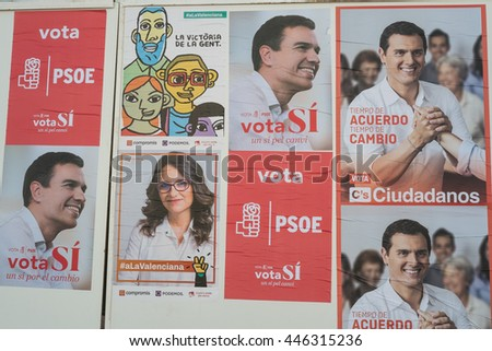 VALENCIA, SPAIN-JUNE 10, 2016: Political campaign posters depicting several presidential candidates on the kickoff to the 2016 elections. - stock photo