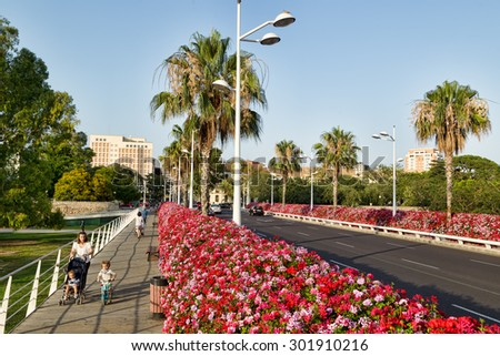 Valencia, Spain - June  30, 2015: Puente de las Flores (Flower Bridge), which opened in 2002,, which is decorated with 27,000 beautiful flowers of all colours, which vary throughout the seasons.