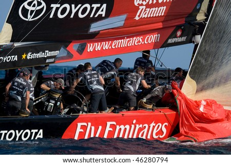 VALENCIA, SPAIN - JUNE 26:  Switzerland's Alinghi in final match of 32nd America's Cup with Team New Zealand  June 26, 2007, in Valencia, Spain. - stock photo