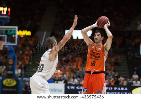 VALENCIA, SPAIN - JUNE 7th: Guillem Vives with ball and Carroll during 3rd playoff match between Valencia Basket and Real Madrid at Fonteta Stadium on June 7, 2016 in Valencia, Spain - stock photo