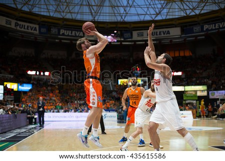 VALENCIA, SPAIN - JUNE 9th: Stefansson with ball and Reyes during 4th playoff match between Valencia Basket and Real Madrid at Fonteta Stadium on June 9, 2016 in Valencia, Spain - stock photo