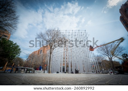 """VALENCIA, SPAIN - MARCH 15: Many workers assemble """"Nou Campanar"""" falla for """"Las Fallas"""" (""""the fires"""" in Valencian) exhibition on march 15, 2015 in Valencia, Spain - stock photo"""