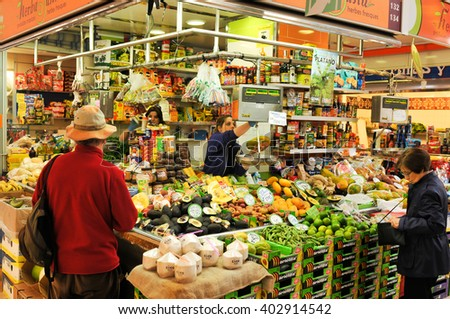 Valencia, Spain - March 30, 2016: People shopping in Mercado Central (Central Market) in Colon, Valencia, Spain.