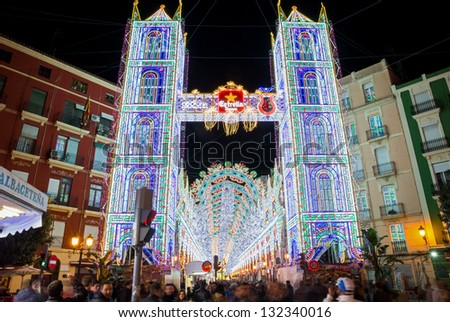 "VALENCIA, SPAIN - MARCH 14: People visit ""Sueca-Literato Azorin"" illumination and falla for ""Las Fallas"" (""the fires"" in Valencian) exhibition on march 14, 2013 in Valencia, Spain - stock photo"