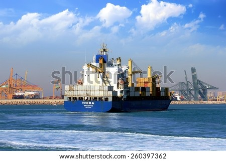 "VALENCIA, SPAIN  MARCH  07: The container ship ""THIRA"" is sailing prepared to enter in the port of Valencia, on march 07, 2015 in Valencia."