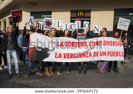 VALENCIA, SPAIN - MARCH 14, 2016: Unidentified protesters in an anti bullfighting demonstrating in the streets of Valencia. Bullfighting currently takes place in nine countries around the world. - stock photo