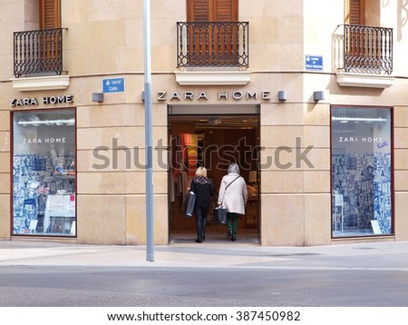 VALENCIA, SPAIN - MARCH 3, 2016. Women who come to shop at the Zara Home store. Zara Home is a company belonging to the Spanish Inditex group dedicated to the manufacturing of home textiles.