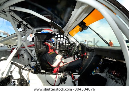 VALENCIA, SPAIN - MAY 2: Team formed by Miguel Angel de Castro and Arturo Melgar races in a Porsche 991 GT3 Cup in the Spanish Endurance Championship, at Ricardo Tormo's Circuit, on May 2, 2015. - stock photo