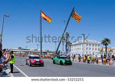 VALENCIA, SPAIN - MAY 16: To promote the Mini Challenge 2010 event, a Mini Cooper gives a demo in the streets of Valencia with the female driver Marta Suria on May 16, 2010 in Valencia, Spain. - stock photo