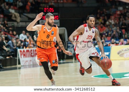 VALENCIA, SPAIN - NOVEMBER 18th: Kitchen (R) witj ball and Diot (L) during Eurocup between Valencia Basket Club and Sluc Nancy at Fonteta Stadium on November 18, 2015 in Valencia, Spain - stock photo