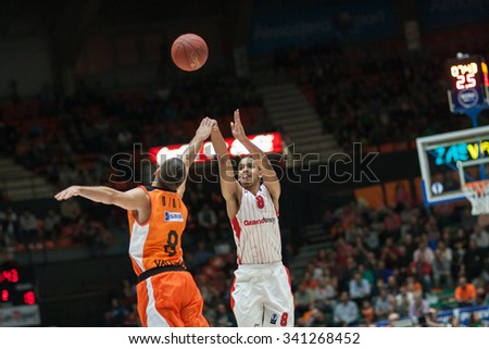 VALENCIA, SPAIN - NOVEMBER 18th: Sene (8) and Diot (L) during Eurocup between Valencia Basket Club and Sluc Nancy at Fonteta Stadium on November 18, 2015 in Valencia, Spain - stock photo