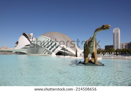 VALENCIA, SPAIN - OCT 9: Dinosaur sculpture and the L'Hemisferic in the City of Arts and Sciences. October 9, 2011 in Valencia, Spain - stock photo